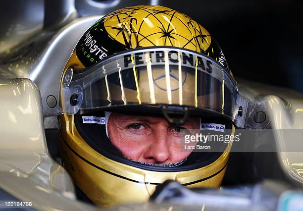 Michael Schumacher of Germany and Mercedes GP prepares to drive wearing a specially designed gold drivers helmet as he commemorates the 20th...