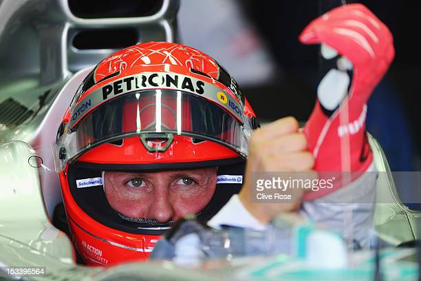 Michael Schumacher of Germany and Mercedes GP prepares to drive during practice for the Japanese Formula One Grand Prix at the Suzuka Circuit on...