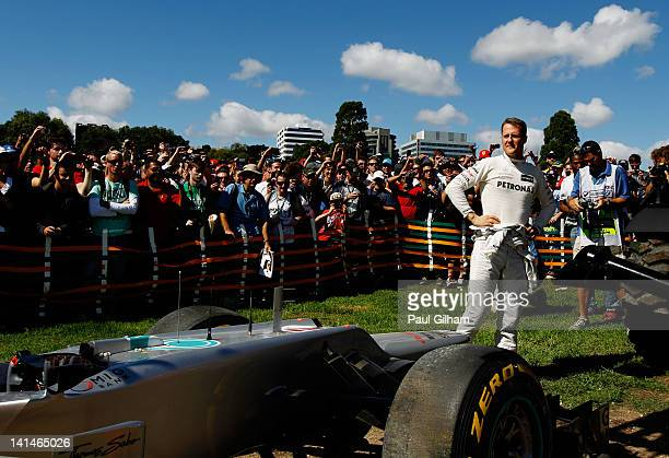 Michael Schumacher of Germany and Mercedes GP stands beside his car after spinning out into the gravel during the final practice session prior to...