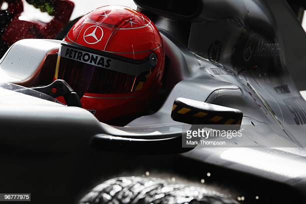 Michael Schumacher of Germany and Mercedes GP stops at his team garage during winter testing at the Circuito De Jerez on February 17 2010 in Jerez de...