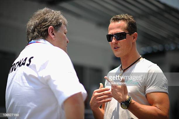 Michael Schumacher of Germany and Mercedes GP talks with Norbert Haug of Mercedes Benz Motorsport during previews to the Brazilian Formula One Grand...