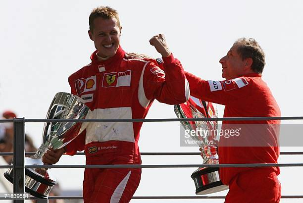 Michael Schumacher of Germany and team principal Jean Todt of Ferrari celebrate after winning the Italian Formula One Grand Prix at Autodromo...