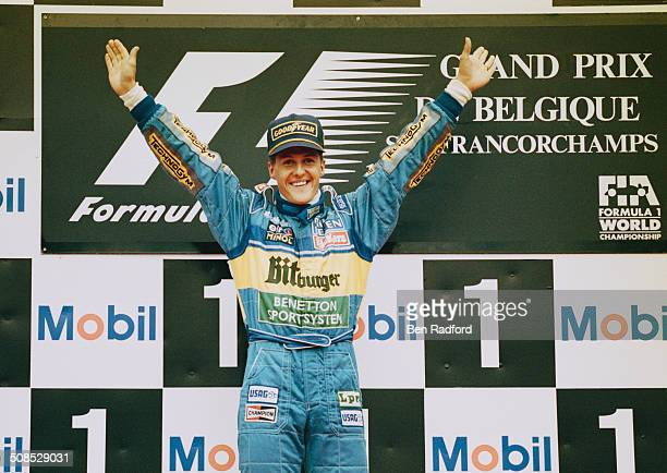 Michael Schumacher of Germany driver of the Mild Seven Benetton Renault Benetton B195 Renault RS7 V10 celebrates winning the Belgian Grand Prix on...
