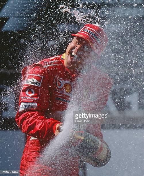Michael Schumacher of Germany driver of the Scuderia Ferrari Marlboro Ferrari F2003GA Ferrari V10 sprays champagne as he celebrates winning the...