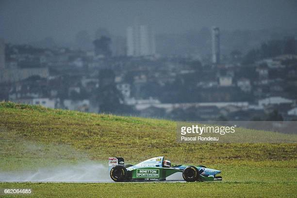 Michael Schumacher of Germany drives the Mild Seven Benetton Ford Benetton B194 Ford ZetecR V8 against the backdrop of Sao Paulo during the Brazilian...