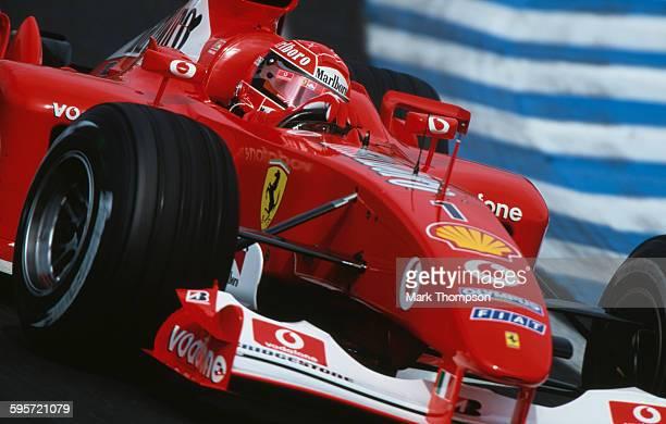 Michael Schumacher of Germany drives the Scuderia Ferrari Marlboro Ferrari F2002 Ferrari V10 during the Brazilian Grand Prix on 6 April 2003 at the...