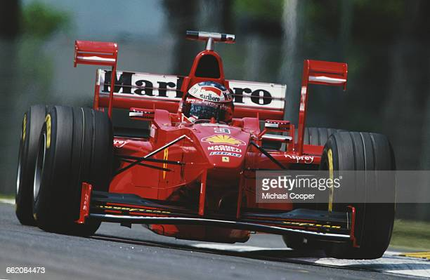 Michael Schumacher of Germany drives the Scuderia Ferrari Marlboro Ferrari F300 V10 with the aerodynamic downforce XWing device during practice for...