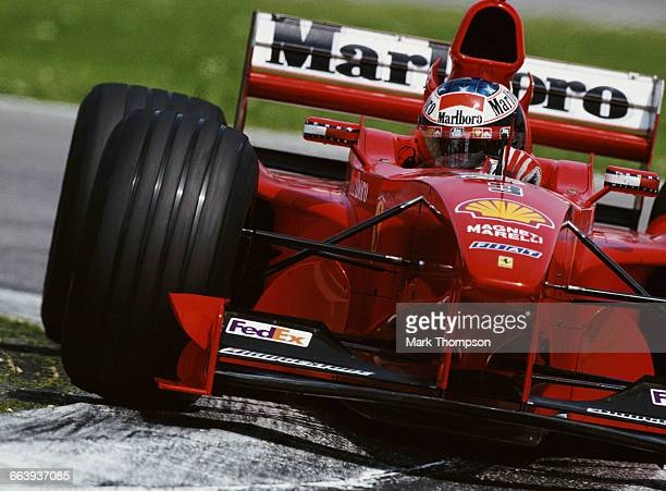 Michael Schumacher of Germany drives the Scuderia Ferrari Marlboro Ferrari F399 Ferrari V10 during the San Marino Grand Prix on 2 May 1999 at the...