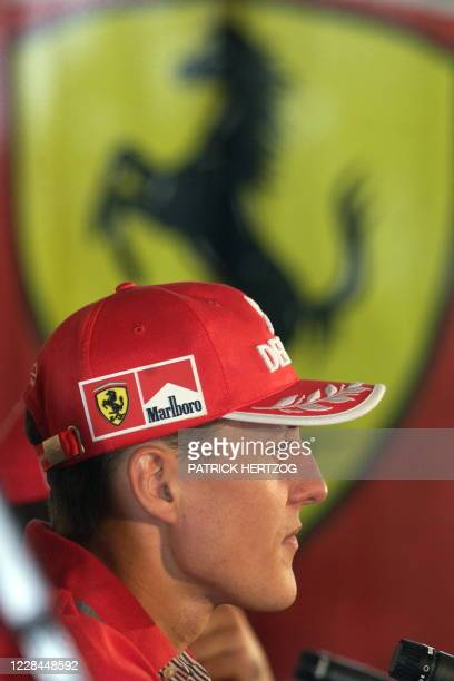 Michael Schumacher of Germany gives a press conference 05 March 1999 two days ahead of the Australian Formula One Grand Prix in Melbourne 07 March...