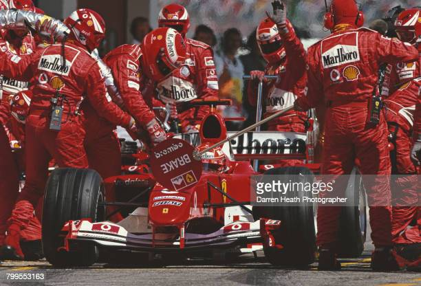 Michael Schumacher of Germany makes a pit stop with the Scuderia Ferrari Marlboro Ferrari F2004 Ferrari V10 on his way to winning the Formula One San...