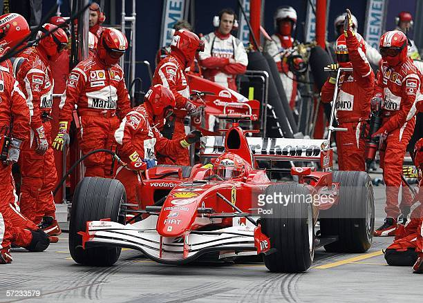 Michael Schumacher of Germany powers his Ferrari out of a pit stop during the Australian Formula One Grand Prix at the Albert Park Circuit on April...