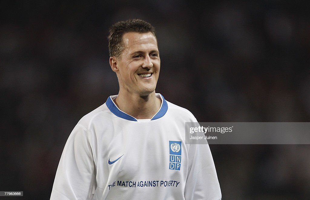 Michael Schumacher of Germany smiles during the fifth Match against Poverty at the La Rosaleda stadium on November 19, 2007 in Malaga, Spain. As Goodwill Ambassadors for the United Nations Development Programme (UNDP), Ronaldo and Zinedine Zidane each year captain an international team for the Match against Poverty soccer match, aimed at mobilizing the public in the fight against poverty.