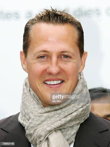 Michael Schumacher poses with school children for the 'Campaign for Safer Roads' at Horse Guard Road on April 23 2007 in London England The campaign...