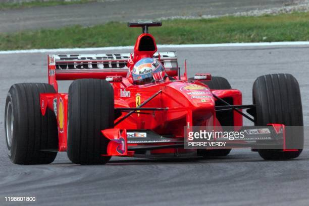 Michael Schumacher substitute Finnish Ferrari driver Mika Salo steers his car on the racetrack during the first free practice session in Spielberg 23...
