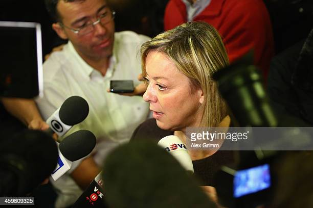 Michael Schumacher's press officer Sabine Kehm talks to the media after a press conference at Grenoble University Hospital Centre on Michael...