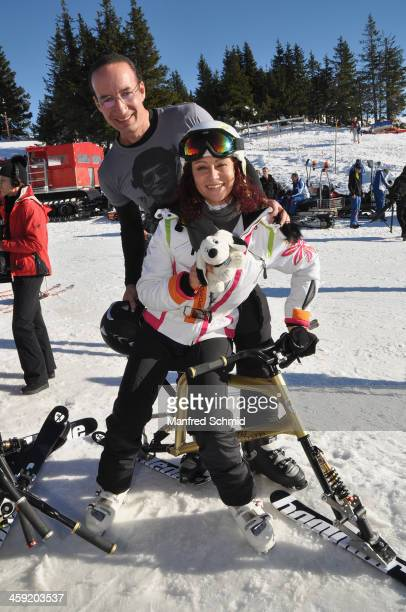 Michael Seida and Christina Lugner pose for a photograph during the Stuhleck skiopening VIP ski race on December 13 2013 in Murzzuschlag Austria