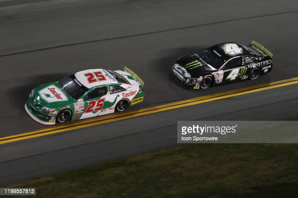 Michael Self driver of the Venturini Motorsports Toyota leads Hailie Deegan driver of the Monster Energy Ford on the final lap during the Lucas Oil...