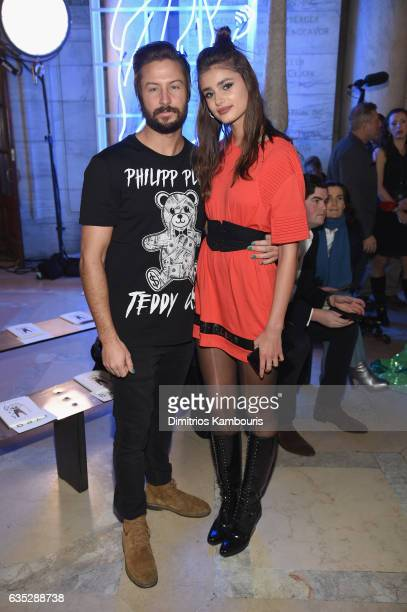 Michael Shank and Model Taylor Hill attends the Philipp Plein Fall/Winter 2017/2018 Women's And Men's Fashion Show at The New York Public Library on...