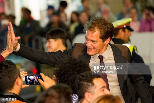 Michael Shannon high 5's a fan at the premiere of 'The Shape of Water' at the Toronto International Film Festival in Toronto Ontario September 11...