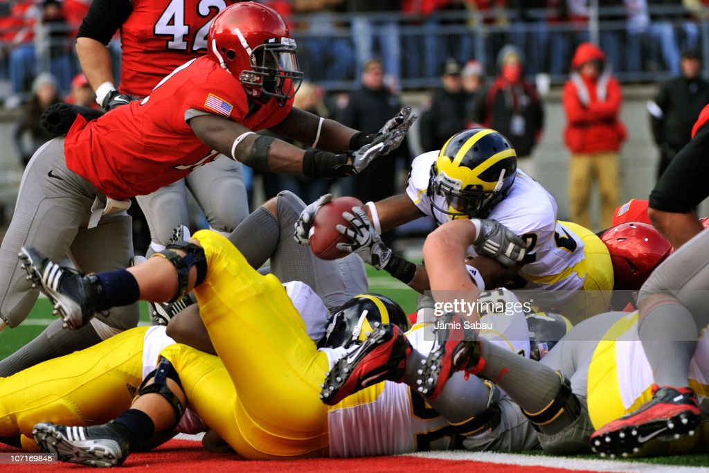 Michael Shaw #20 of the Michigan Wolverines lunges across the goal line for a touchdown in the second quarter against the Ohio State Buckeyes at Ohio Stadium on November 27, 2010 in Columbus, Ohio.