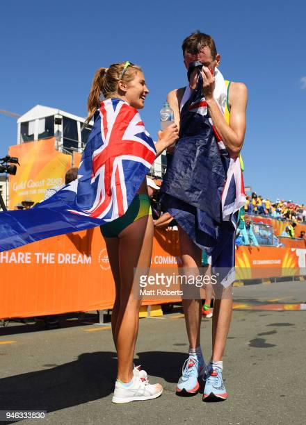 Michael Shelley of Australia celebrates wins gold in the Men's marathon with Women's bronze medalist Jessica Trengove of Australia on day 11 of the...
