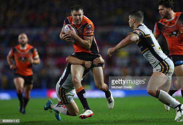 Michael Shenton of Castleford is tackled by Danny McGuire of Leeds during the Betfred Super League Grand Final between Castleford Tigers and Leeds...