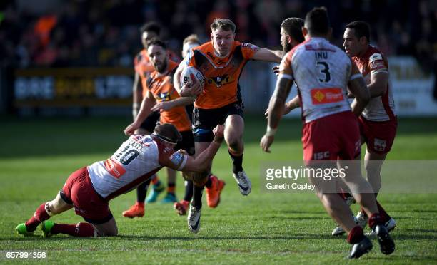 Michael Shenton of Castleford is tackled by Remi Casty of Catalans during the Betfred Super League match between Castleford Tigers and Catalans...
