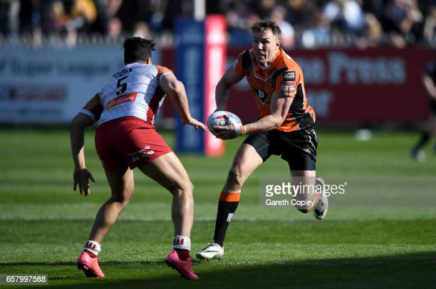 Michael Shenton of Castleford looks to get past Fouad Yaha of Catalans during the Betfred Super League match between Castleford Tigers and Catalans...