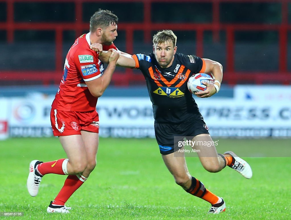 Michael Shenton of Castleford Tigers gets away from Liam Salter of Hull KR during the Roger Millward Trophy match between Hull KR and Castleford Tigers as part of the Betfred Super League at KCOM Stadium on June 1, 2018 in Hull, England.