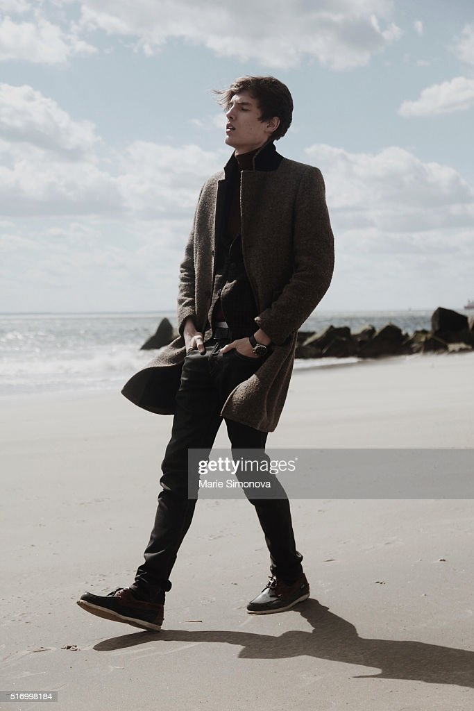 Michael Shmatov wearing H&M coat, Gap turtleneck and Levi's trousers seen on March 21, 2016 in Coney Island, New York City.