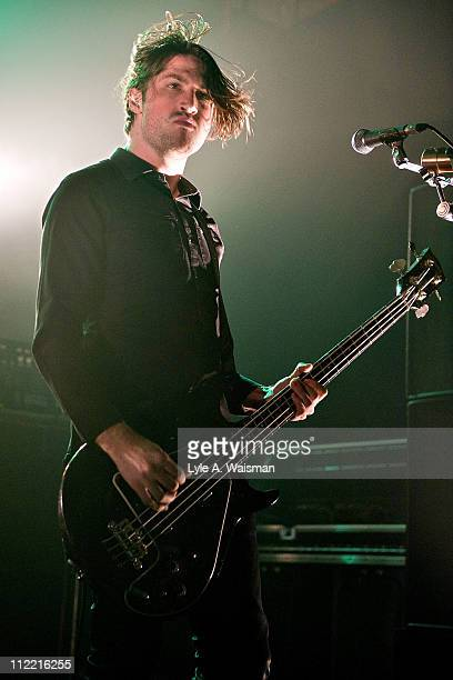 Michael Shuman of Queens of the Stone Age performs at the Riviera Theatre on April 1, 2011 in Chicago, Illinois.