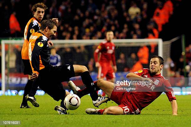 Michael Silberbauer of FC Utrecht and Joe Cole of Liverpool battle for the ball during the UEFA Europa League Group K match between Liverpool and FC...