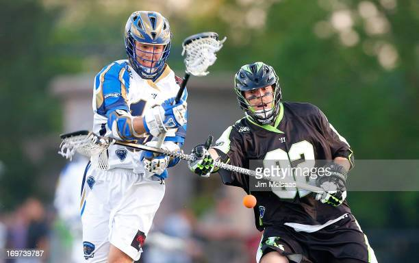 Michael Skudin of the New York Lizards battles for a loose ball against Kevin Drew of the Charlotte Hounds during their Major League Lacrosse game at...