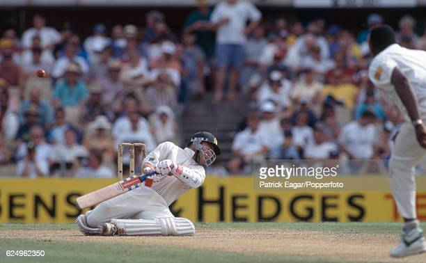 Michael Slater of Australia ducks a bouncer from England bowler Devon Malcolm during the 3rd Test match between Australia and England at the SCG...