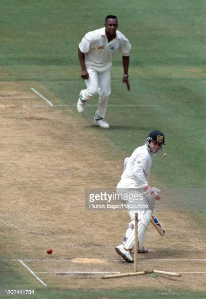 Michael Slater of Australia looks back at his shattered stumps as he is bowled for 11 runs by Devon Malcolm of England during the 3rd Test match...