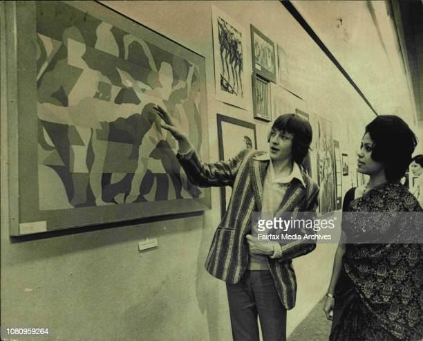 Michael Smith 17 yrs explaining the meaning of his painting to Mrs Kamalini Malhotra the painting called 'Dance' was awarded a Major PrizeYoung World...