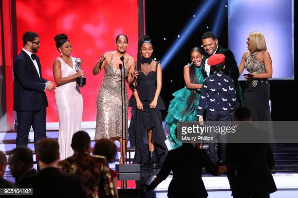 Michael Smith and Jemele Hill present the Outstanding Comedy Series award for 'blackish' to Tracee Ellis Ross Yara Shahidi Marsai Martin Anthony...