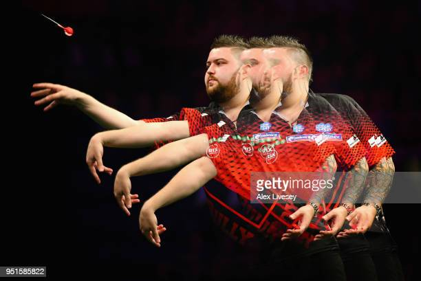 Michael Smith in action during his match against Michael van Gerwen in the 2018 Unibet Premier League at The Manchester Arena on April 26 2018 in...