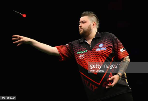 Michael Smith in action during his match against Peter Wright in the 2018 Unibet Premier League at The Manchester Arena on April 26 2018 in...