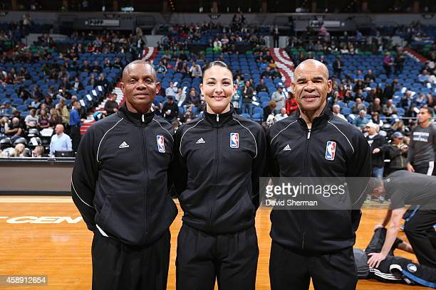 Michael Smith Lauren Holtkamp and Danny Crawford pose for a photo during the game between the Detroit Pistons and the Minnesota Timberwolves during...
