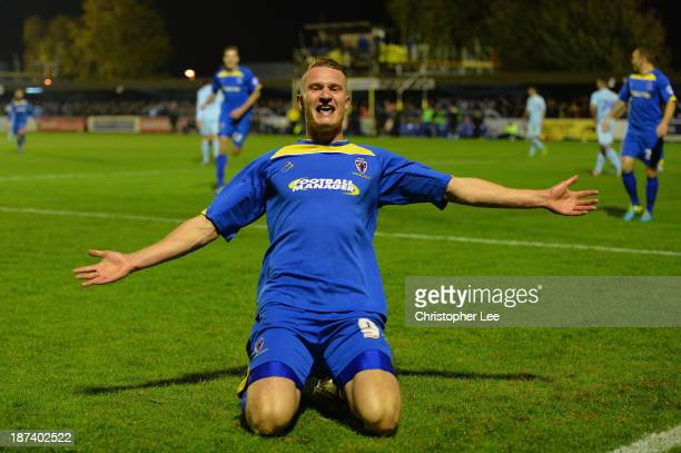 Michael Smith of AFC Wimbledon celebrates scoring their first goal during the FA Cup First Round match between AFC Wimbledon and Coventry City at The...