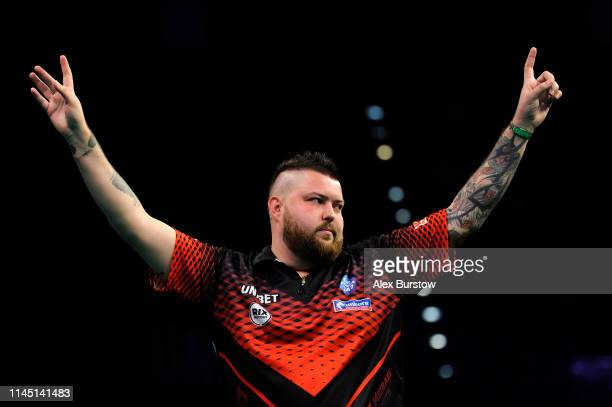 Michael Smith of England celebrates during his match against Mensur Suljovic of Austria during the 2019 Unibet Premier League Darts at Arena...