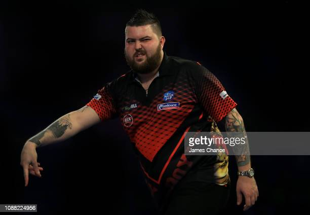 Michael Smith of England celebrates during the 2019 William Hill World Darts Championship SemiFinal match between Nathan Aspinall and Michael Smith...