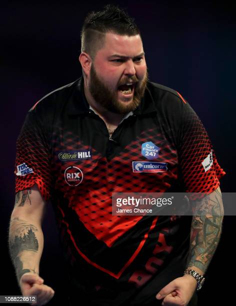Michael Smith of England celebrates during the 2019 William Hill World Darts Championship Semi-Final match between Nathan Aspinall and Michael Smith...