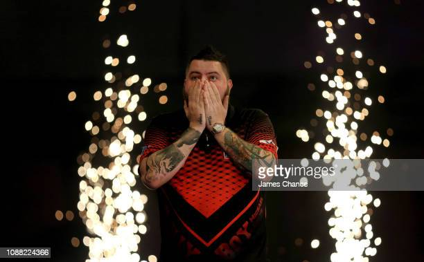 Michael Smith of England celebrates victory over Nathan Aspinall of England after the 2019 William Hill World Darts Championship Semi-Final match...
