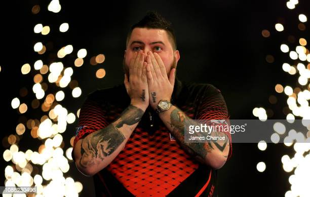 Michael Smith of England celebrates victory over Nathan Aspinall of England after the 2019 William Hill World Darts Championship SemiFinal match...
