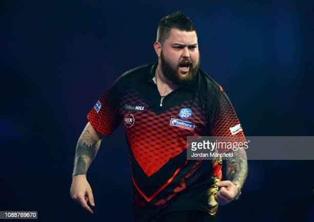 Michael Smith of England celebrates winning a leg during the Final match against Michael van Gerwen of the Netherlands during Day 17 of the 2019...