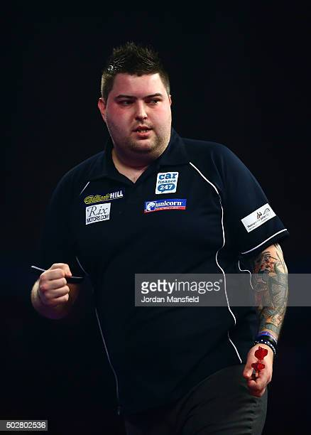 Michael Smith of England celebrates winning his third round match against Benito van de Pas of Holland on Day Eleven of the 2016 William Hill PDC...