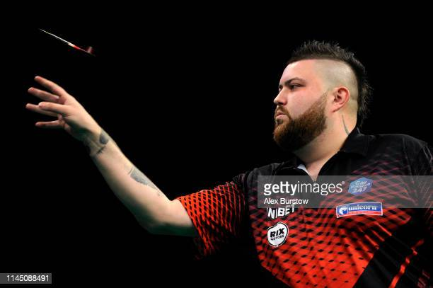 Michael Smith of England in action against Mensur Suljovic of Austria during the 2019 Unibet Premier League Darts at Arena Birmingham on April 25...