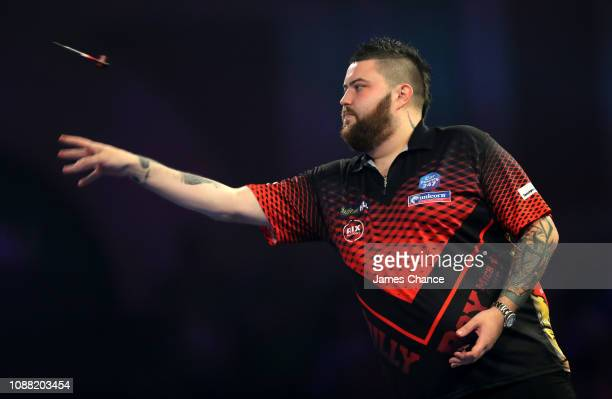 Michael Smith of England in action during the 2019 William Hill World Darts Championship SemiFinal match between Nathan Aspinall and Michael Smith at...